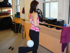 "Pilates on Fifth Instructor Michelle teaching Hamstring Press Series with XTENDâ""¢ Ball at the Barre"